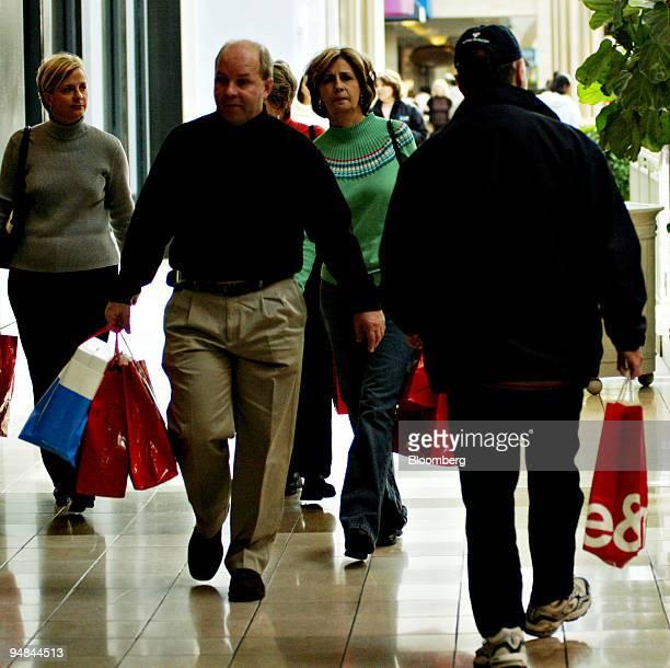 Shoppers carry bags inside the Lenox Mall Atlanta, Georgia, Friday, November 25, 2005.