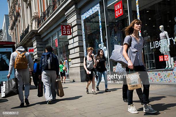 Shoppers carry bags with purchased clothes on Oxford Street on June 9 2016 in London England Conditions are tough for the High Street as retailers...