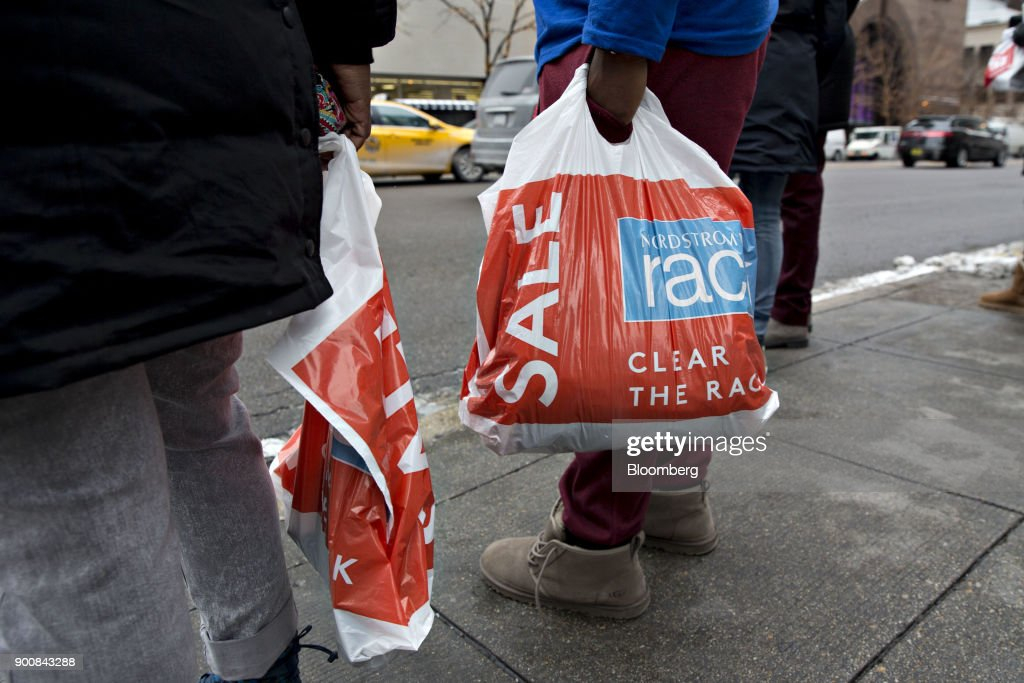 Shoppers carry Nordstrom Inc. Rack bags while walking through the Magnificent Mile commercial district in Chicago, Illinois, U.S., on Friday, Dec. 29, 2017. Bloomberg is scheduled to release consumer comfort figures on January 4. Photographer: Daniel Acker/Bloomberg via Getty Images