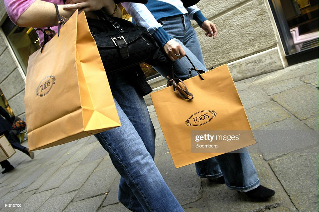 7a856271f7d Shoppers carry Tod's bags in Milan, Italy, Thursday, March 3 : News Photo
