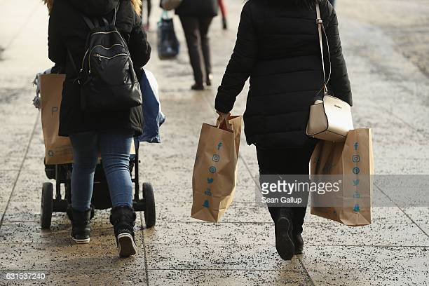 Shoppers carrying shopping bags from discount clothing retailer Primark walk in the city center on January 12 2017 in Berlin Germany In Germany the...