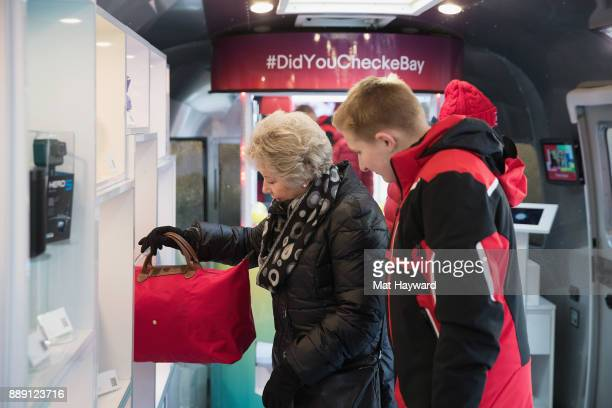 Shoppers check out merchandise during the 'Did You Check eBay' Holiday Airstream tour at Westlake Center Plaza on December 9 2017 in Seattle...