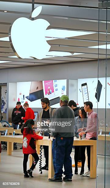 Shoppers check out products at the Apple Store at the City Creek Center looking for 'Black Friday' deals on November 25 2016 in Salt Lake City Utah...