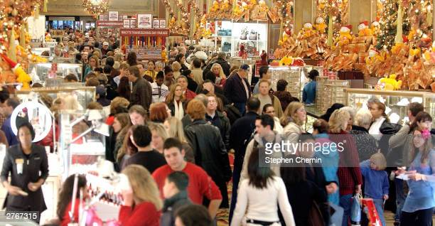 Shoppers clog the aisles at Macy's Department store November 28 2003 in New York City Black Friday the day after Thanksgiving and traditionally the...