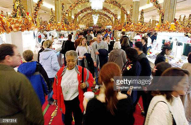 Shoppers clog the center aisle at Macy's Department store November 28 2003 in New York City Black Friday the day after Thanksgiving and traditionally...