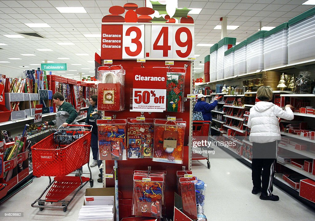 Shoppers comb through discounted Christmas holiday gift wrap ...