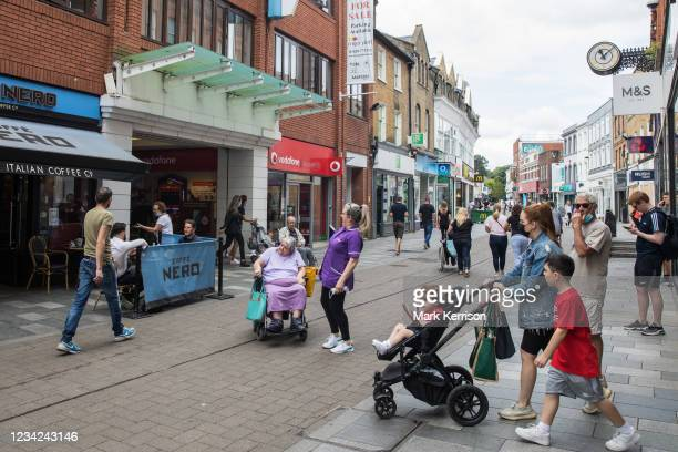 Shoppers come and go between high street shops on 27th July 2021 in Maidenhead, United Kingdom. Many independent high street businesses are believed...