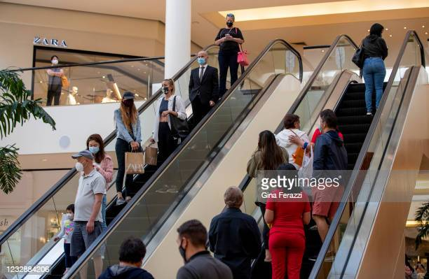 Shoppers continue to wear masks inside South Coast Plaza on May 13, 2021 in Costa Mesa, California. Even though, the CDC announced Thursday that...