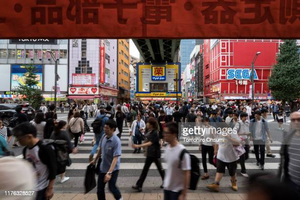 Shoppers cross a road in the Akihabara shopping district on September 21, 2019 in Tokyo, Japan. Japanese consumers are preparing ahead of the planned...