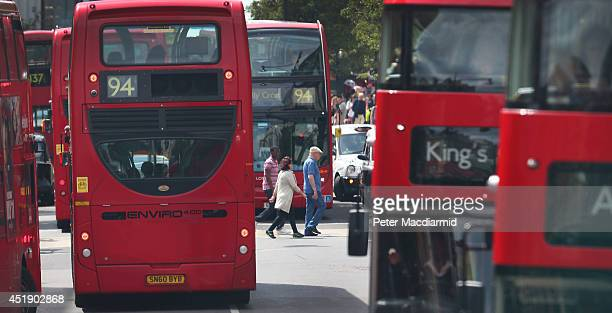 Shoppers cross Oxford Street between a line of buses and taxis on July 9 2014 in London England Researchers from King's College London have found...