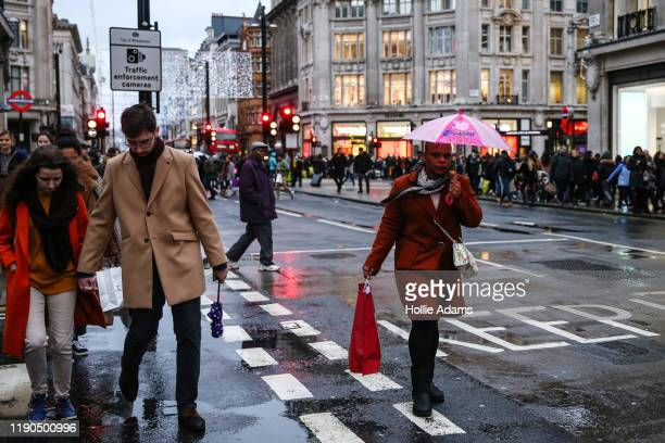 Shoppers cross Oxford Street during the annual Boxing Day Sales on December 26 2019 in London England