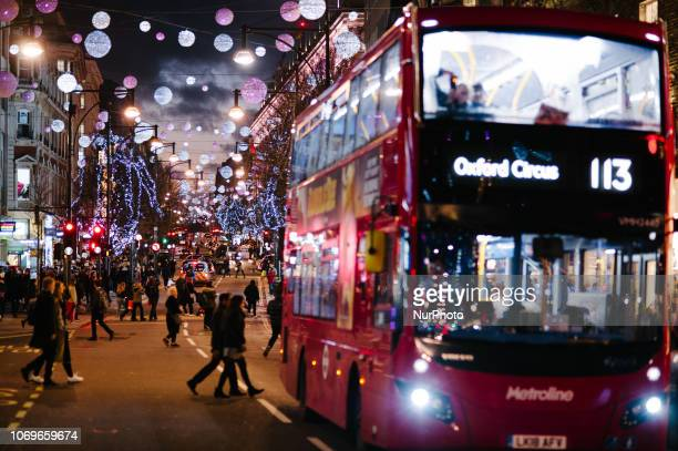 Shoppers cross Oxford Street in London England on December 7 2018 Christmas shopping season is in full swing in London with just over two weeks to go...