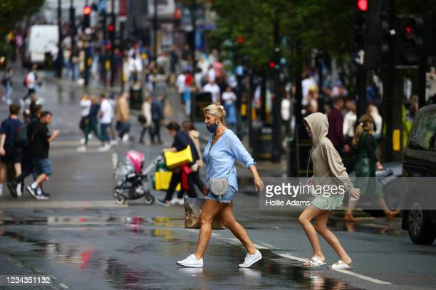 Shoppers cross Oxford Street on July 31, 2021 in London, England. The United Kingdom, considered one of the advanced world's worst hit economies by...