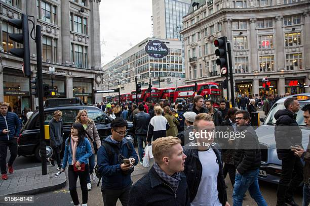 Shoppers cross the road in Oxford Circus on October 19 2016 in London England Inflation rose to 10% in September up from 06% in August according to...