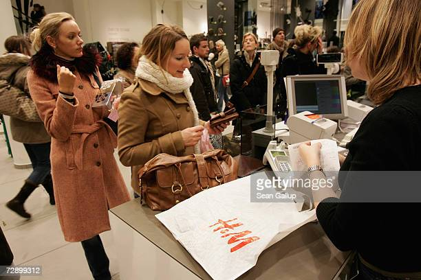 Shoppers crowd a HM clothing store December 7 2006 in Berlin Germany Swedish retailer HM has become one of Europe's biggest clothing chains