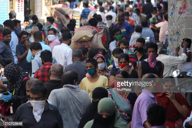 Shoppers crowd a street in the Dharavi slum area of Mumbai India on April 23 2020 India continues in nationwide lockdown to control the spread of the...