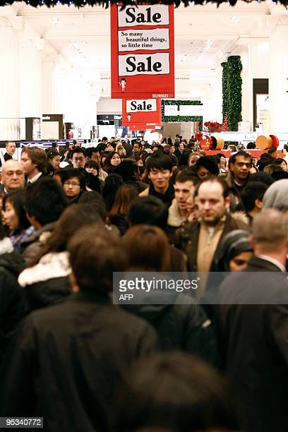 Shoppers crowd in Selfridges as the store opens it doors on the first day of its winter sale on Boxing Day 2009 in London on December 26 2009 AFP...