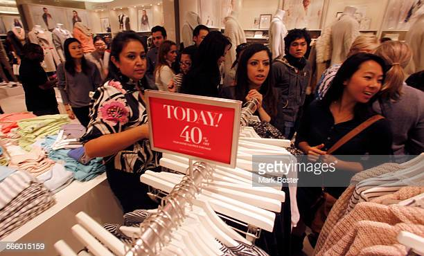 Shoppers crowd into the Ann Taylor for a chance to get 50% off all purchases in the store until noon at South Coast Plaza in Costa Mesa for Black...