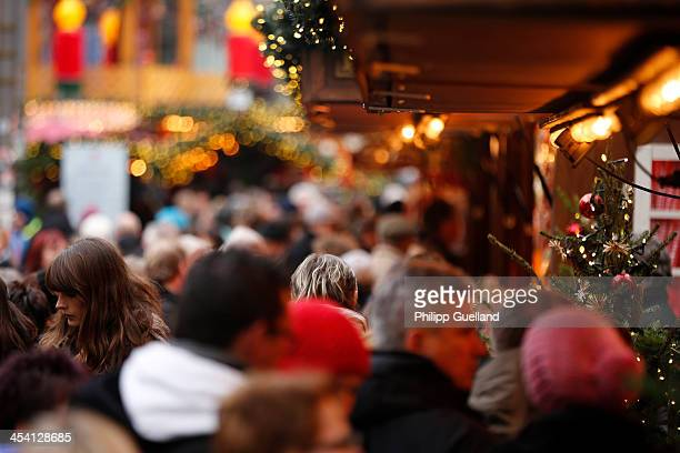 Shoppers crowd on the christmas market in the main pedestrian street on December 7 2013 in Hamburg Germany According to a recent study people in...
