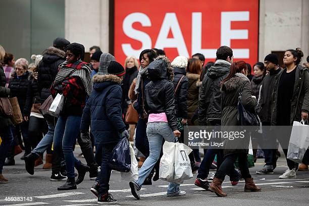 Shoppers crowd Oxford Street during the Boxing Day sales on December 26 2013 in London England Statistics have shown that this year people are more...
