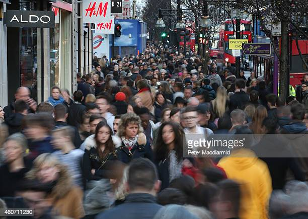 Shoppers crowd Oxford Street on December 20 2014 in London England Shoppers in the United Kingdom are expected to spend £12 billion on the last...