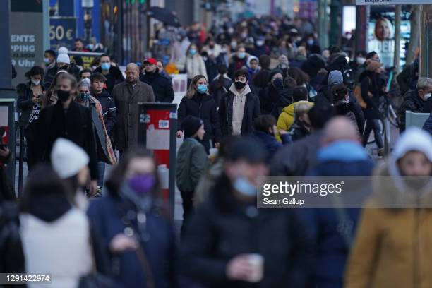 Shoppers crowd Tauentzienstrasse on the last day before most shops are to close under a hard lockdown before Christmas during the second wave of the...