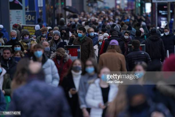 Shoppers crowd Tauntzienstrasse shopping street on Black Friday weekend during the second wave of the coronavirus pandemic on November 28, 2020 in...