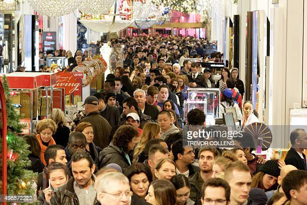 Shoppers crowd the aisles in Macys department store in Herald Square New York on November 26 2015 Many retail outlets opened their doors to bargain...