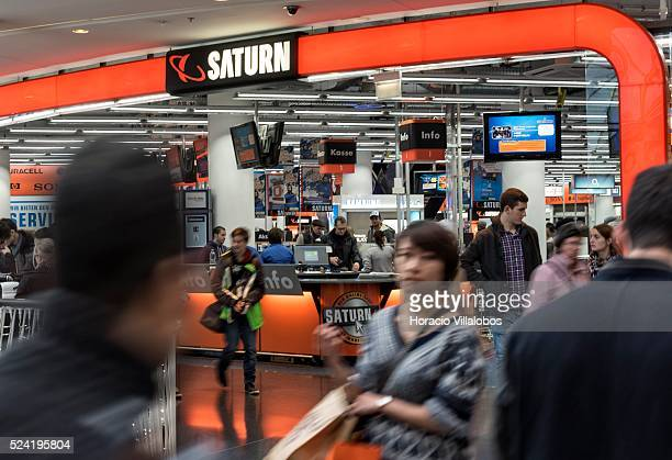 Shoppers crowd the entrance of Saturn one of the big players in German electronics retail business at Christmas decorated MyZeil Shopping Center in...