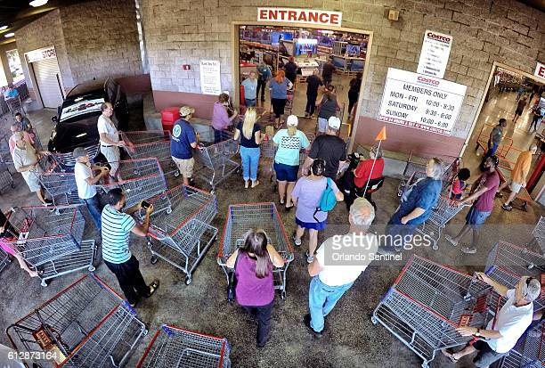 Shoppers crowd the entrance to the Costco store on Oct 5 2016 in Altamonte Springs Fla as central Floridians prepare for the anticipated strike of...