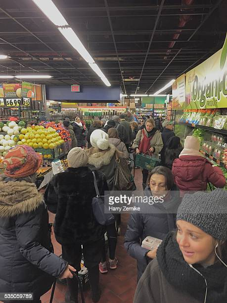 Shoppers crowd the Fairway grocery store on E86th street in Manhattan stocking up in anticipation of the coming blizzard January 26 2015