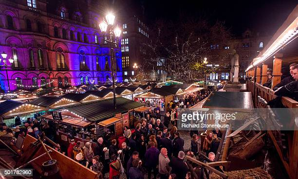 Shoppers enjoy Manchester's Christmas Market with food stalls bar's Christmas decorations and various gift stalls outside Manchester Town Hall on...