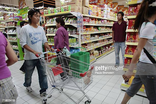 Shoppers enjoy the brand new 2 storey Baiyi Supermarket in the new part of Lhasa city on August 4 2006 in Lhasa of Tibet Autonomous Region China...