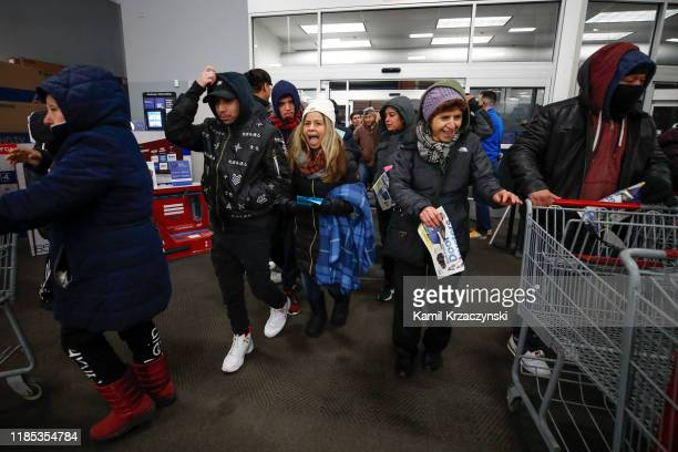 Shoppers enter a Best Buy Inc store on November 28 2019 in Chicago Illinois Known as 'Black Friday' the day after Thanksgiving marks the beginning of...