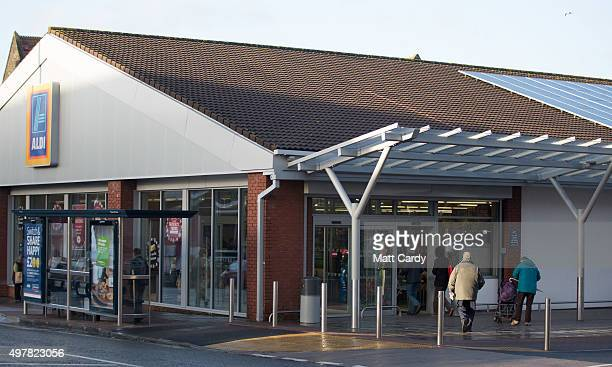 Shoppers enter a branch of Aldi on November 18 2015 in Bristol England As the crucial Christmas retail period approaches all the major supermarkets...
