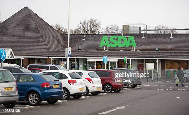 Shoppers enter a branch of Asda on November 18 2015 in Bristol England As the crucial Christmas retail period approaches all the major supermarkets...
