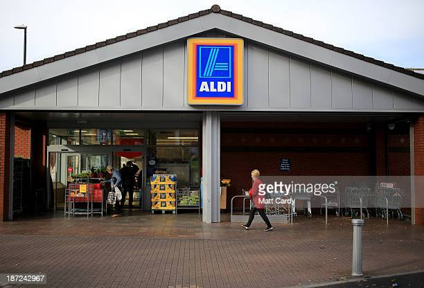 Shoppers enter a branch of the budget supermarket Aldi on November 7 2013 in Bristol England As the German chain opens its 500th store in the...