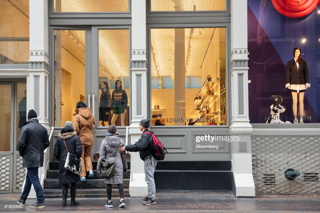 Shoppers enter a LVMH Moet Hennessy Louis Vuitton SE store in the SoHo neighborhood of New York, U.S., on Friday, Feb. 9, 2018. Bloomberg is scheduled to release consumer comfort figures on February 15. Photographer: Sarah Blesener/Bloomberg via Getty Images