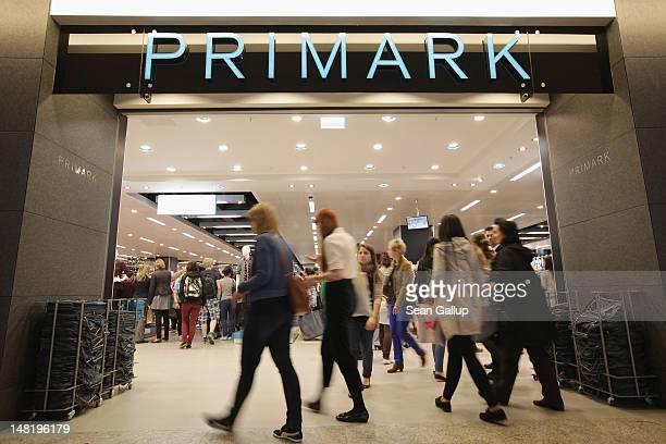 Shoppers enter a Primark clothing store a day after the store's opening on July 12 2012 in Berlin Germany Primark is expanding aggressively in...