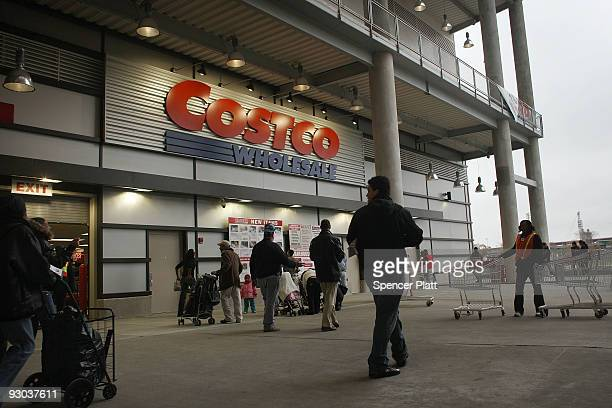 Shoppers enter a recently opened Costco warehouse store on November 13 2009 in New York City The store the first in Manhattan opened in a former wire...