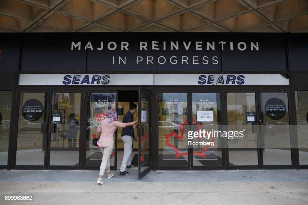 Shoppers enter a Sears Canada Inc store inside a mall in Toronto Ontario Canada on Thursday June 22 2017 Canadian retailer Sears Canada Inc is...