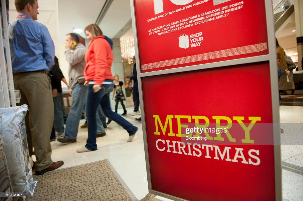Shoppers enter a Sears Holdings Corp. store ahead of Black Friday in Peoria, Illinois, U.S., on Thursday, Nov. 28, 2013. U.S. retailers will kick off holiday shopping earlier than ever this year as stores prepare to sell some discounted items at a loss in a battle for consumers. Photographer: Daniel Acker/Bloomberg via Getty Images