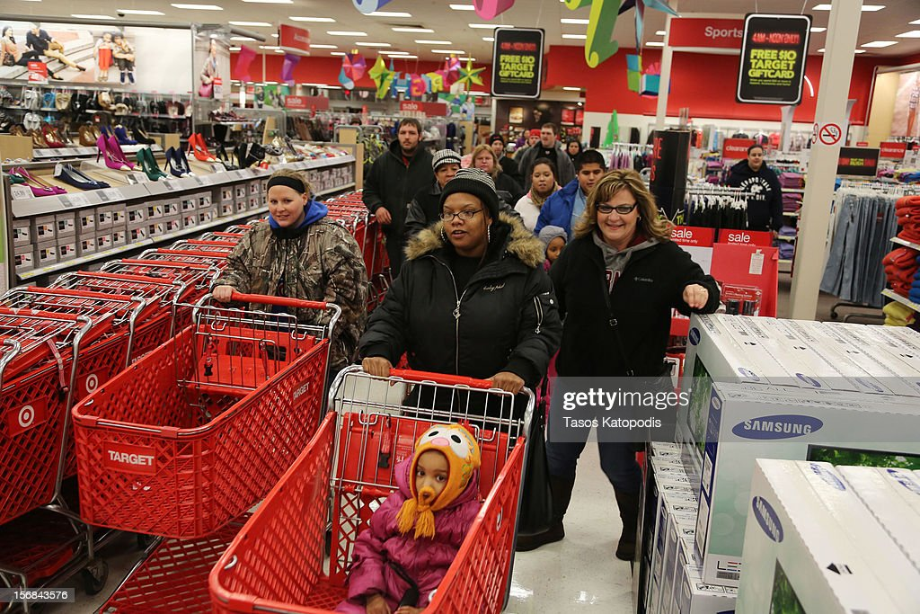 Shoppers enter a Target on Thanksgiving night November 22, 2012 in Highland, Indiana. Many stores got a head start on the traditional Black Friday sales by opening on Thanksgiving.