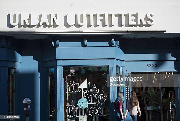 Shoppers enter an Urban Outfitters Inc store in San Francisco California US on Friday Nov 18 2016 Urban Outfitters Inc is expected to release...