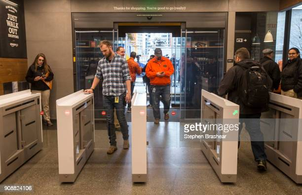 Shoppers enter and check out with purchases at the Amazon Go on January 22 2018 in Seattle Washington After more than a year in beta Amazon opened...