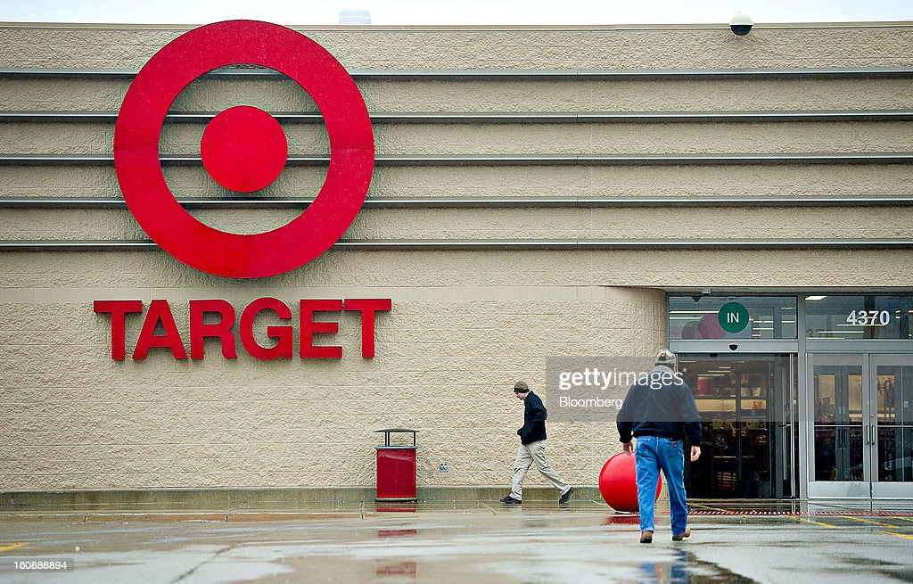 Shoppers enter and exit a Target Corp. store in Peru, Illinois, U.S., on Thursday, Feb. 7, 2013. Target Corp. led U.S. retailers to the biggest monthly same-store sales gain in more than a year as shoppers snapped up discounted merchandise chains were clearing out after the holidays. Photographer: Daniel Acker/Bloomberg via Getty Images