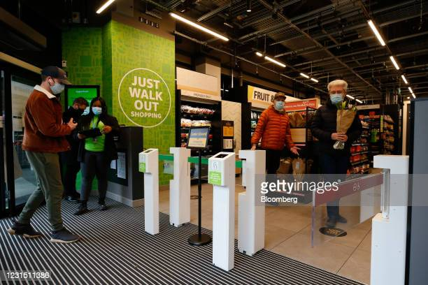 Shoppers enter and exit the Amazon.com Inc. Amazon Fresh cashierless convenience store in the Ealing area of London, U.K., on Thursday, March 4,...