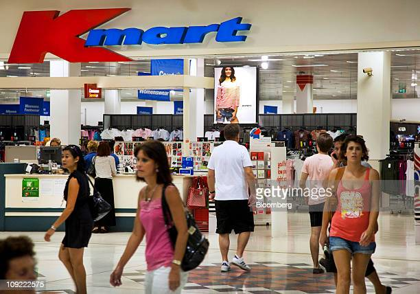 Shoppers enter and exit Wesfarmers Ltd's Kmart store in Innaloo a suburb of Perth Australia on Thursday Feb 17 2011 Wesfarmers whose businesses range...