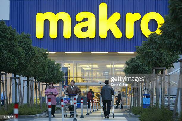 Shoppers enter and leave a Makro discount supermarket and retailer October 21 2003 in Pilsen Czech Republic Makro is a subsidiary of Metro AG of...