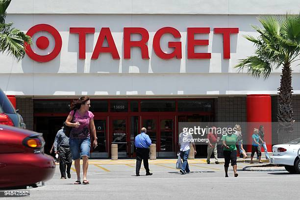 Shoppers enter and leave a Target department store in Tampa Florida US on Thursday May 1 2008 US consumer spending rose more than forecast in March...